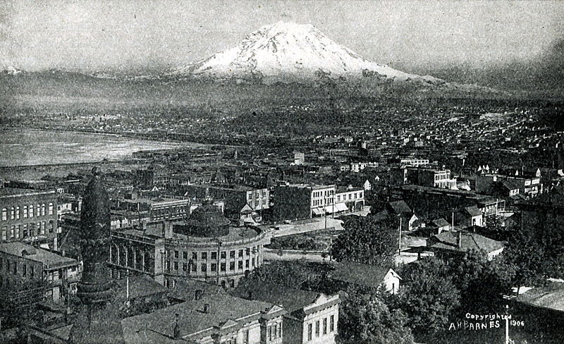 Image 10. This is a birds-eye view of Tacoma, Washington looking northeast towards Mount Rainier [Mount Tacoma] in 1906. Photographer not given but has A. H. Barnes on photo.