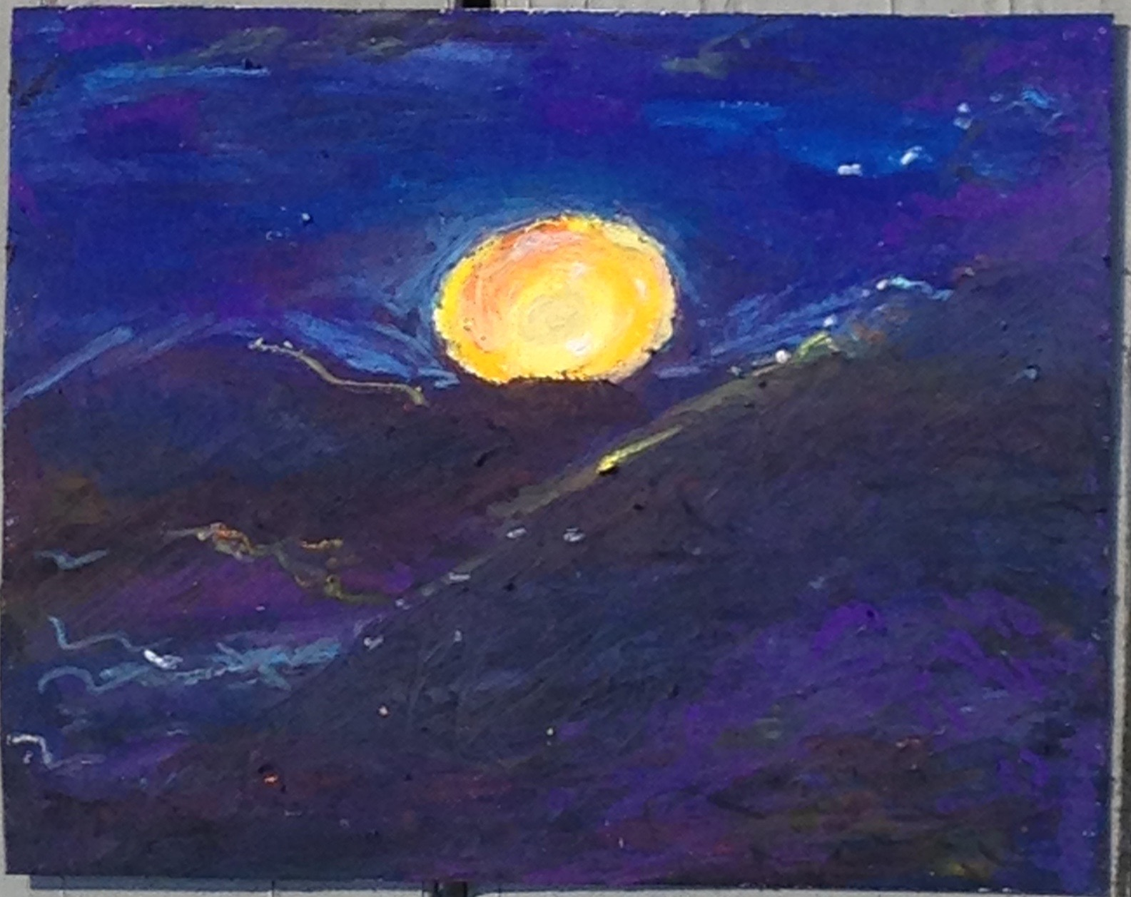 Image 1. Sun setting behind mountains. Oil pastels on paper. April, 2013. Painting and photo by author, uploaded October 25, 2015.