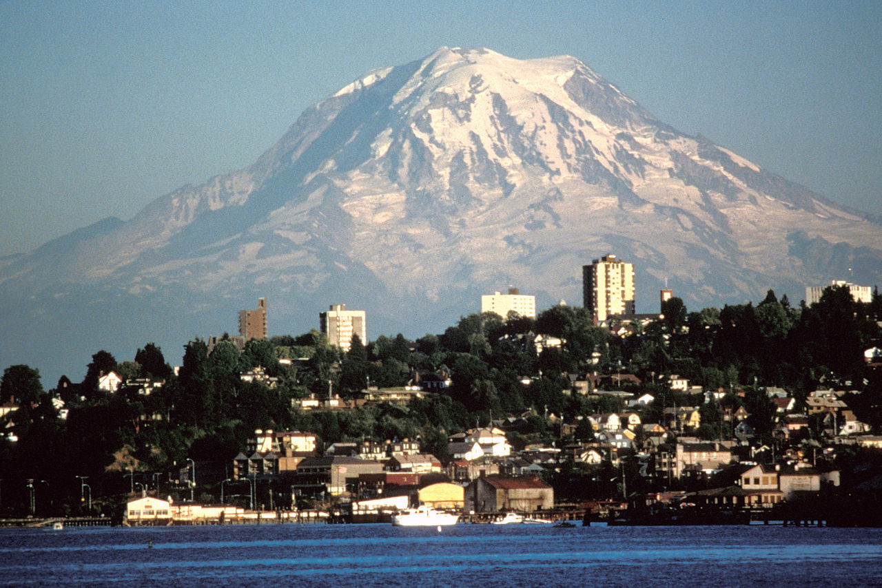 Image 1. Mount Ranier (= Takhoma = Tacoma), viewed from the northwest (the city of Tacoma, Washington, USA), Liberty Cap is the apparent summit with Mowich Face below. Photo by Lyn Topinka (USGS). (title amended by author)