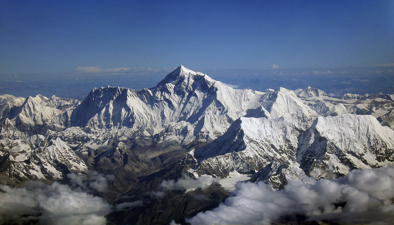 Image 6. Mount Everest [= Chomolungma] as seen from an aircraft from airline company Drukair in Bhutan. The aircraft is south of the mountains, facing North. Photo by shrimpo1967.