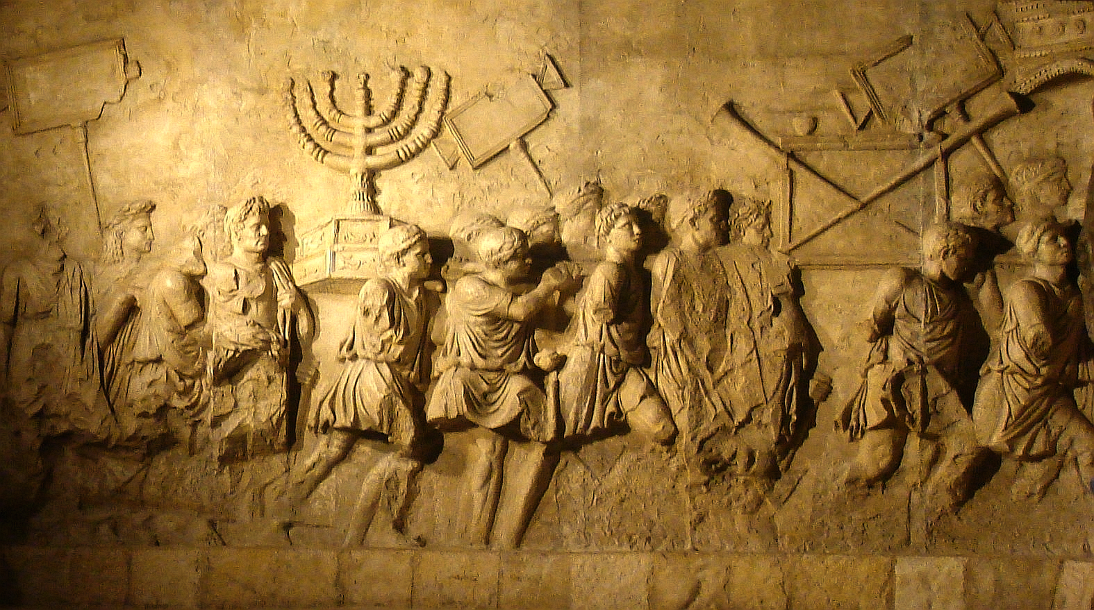 Image 2. Depiction of the Roman ... Sack of Jerusalem [of 70 CE] on the Arch of Titus in Rome (copy from Beth Hatefutsoth). The procession features the Menorah and other vessels taken from the Second Temple. Photo is a derivative work: Steerpike (talk), Arc_de_Triumph_copy.jpg : user: בית השלום.