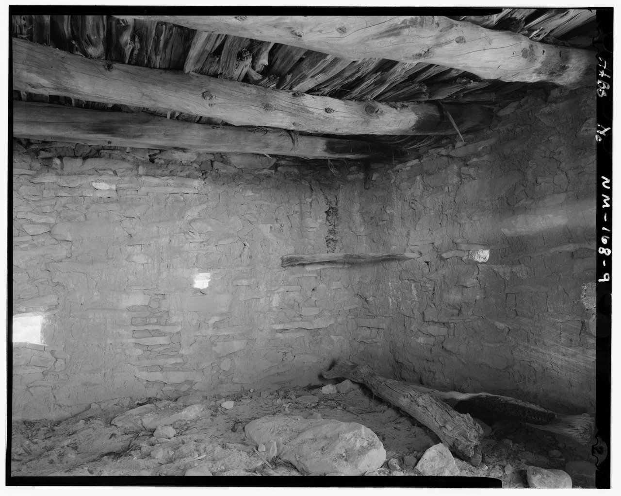 Image 7. Detail of room two, showing wall, ceiling and loop holes. Gobernador Knob, the sacred emergence point of the Navajo, can also be seen from the site. This is a Pueblito, a small multi-roomed masonry dwelling found in the Navajo homeland, or Dinetah region of northwest New Mexico. Constructed between 1749 and 1753. — Gould Pass Pueblito, Carrizo Canyon, Dulce, Rio Arriba County, NM, USA). ... From the Historic American Buildings Survey (HABS), Historic American Engineering Record (HAER) or Historic American Landscapes Survey (HALS). These are programs of the National Park Service established for the purpose of documenting historic places. Records consist of measured drawings, archival photographs, and written reports.. (title edited by author)