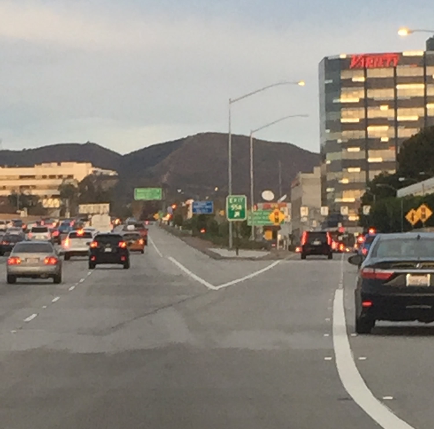 Image 12. A low peak in the Santa Monica Mountain Range as seen from inside a car on the 405 Freeway driving north, Los Angeles, California, USA. Photo by Adelle Hersh, January, 13, 2016. Used with permission of Adelle Hersh.