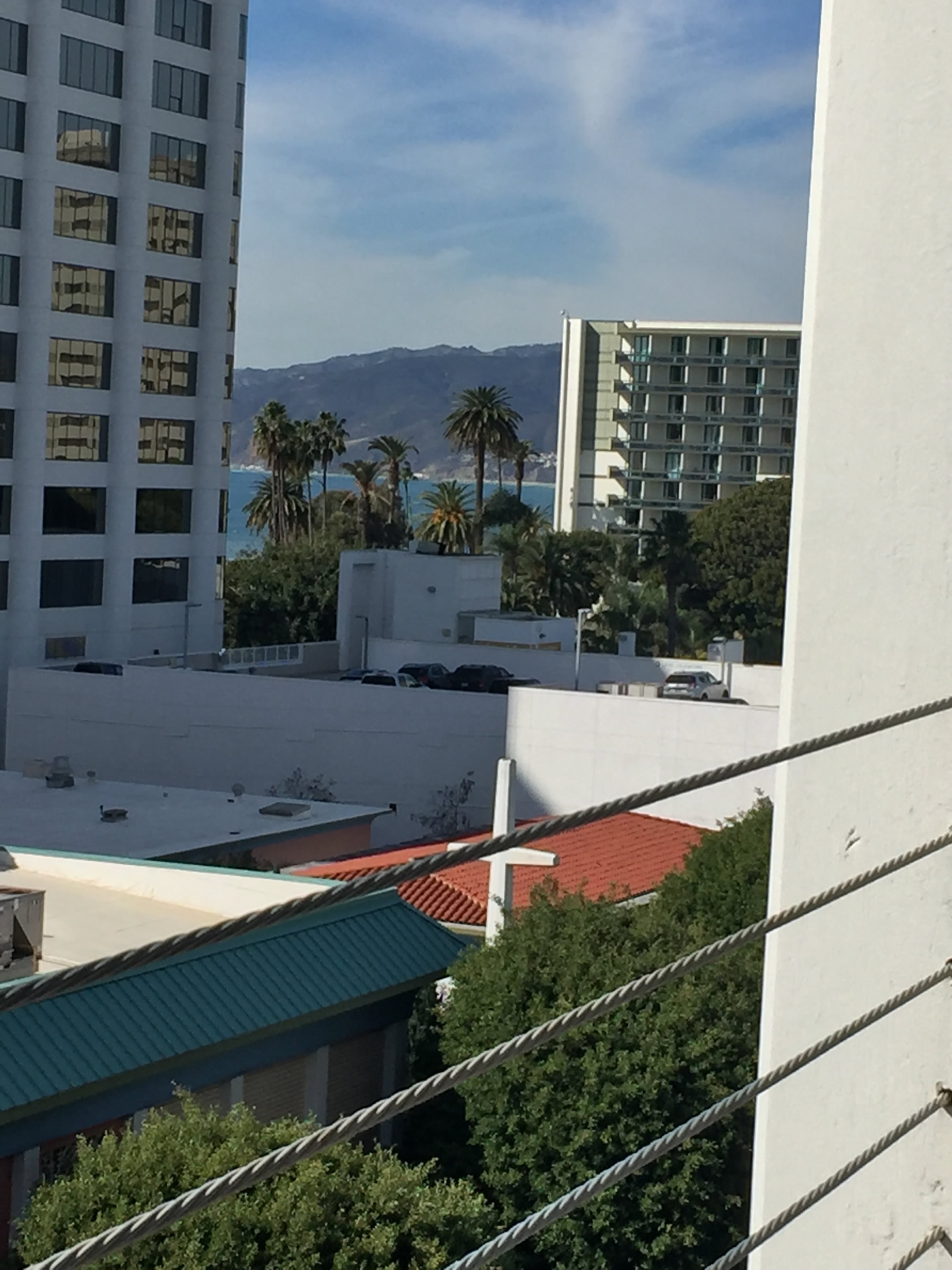 Image 19. Santa Monica (the city), the Santa Monica Mountains (background), and the Pacific Ocean (from a parking structure in Santa Monica, California, USA). Photo by Adelle Hersh, 21 January 2016. Used with permission.